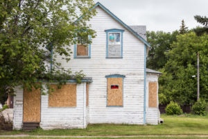 Boarded up house photo